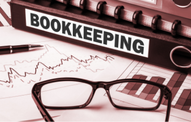 Picture of a binder that says Bookkeeping on it.